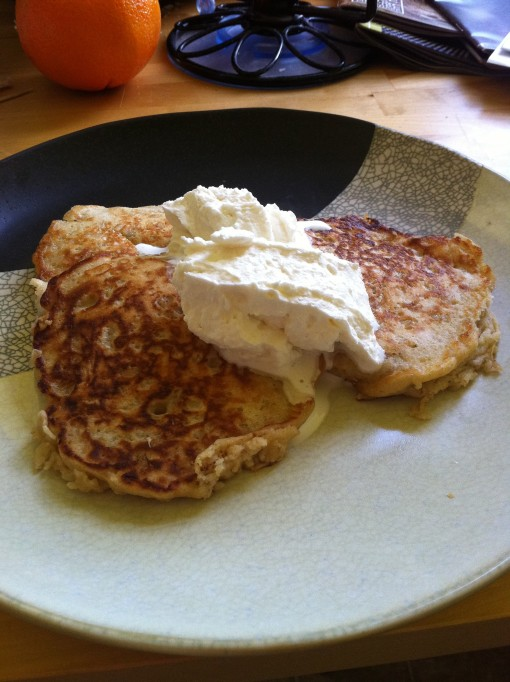 Oatmeal pancakes with whipped cream